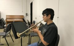 Allegra Tomores,  who is music major shows off her musical talent by practicing her trumpet in one of the music room in the Humanities building.