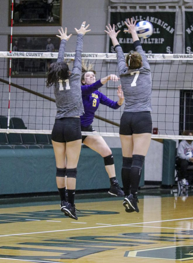 Sophomore Livia De Pra and Freshman Seyun Park jump up to block the ball in the second match. The Lady Saints won this one 25-16.