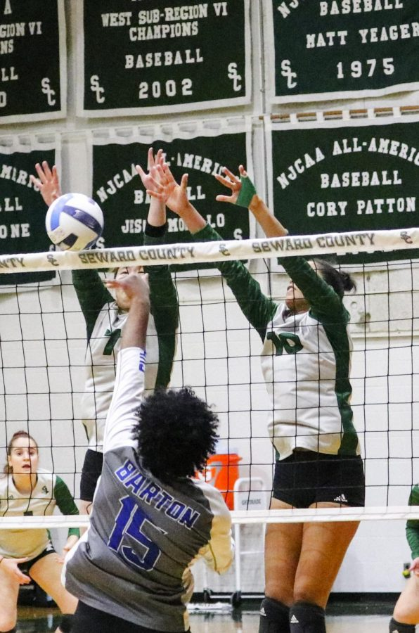 Lady Saints Seyun Park and Ariana Arciniega jump to try to block the ball from Barton community college's Maria Santos. Arciniega had one service ace, 19 kills, and three blocks in the game. Park had nine kills.