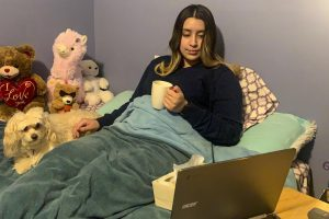 Freshman Maria Coronado finally has a chance to enjoy aspects of a traditional snow day on Monday  — mocha coffee and watching Netflix under covers. She spent most of the day in remote learning and doing homework. Her dog, Tomasa, and stuffed animal friends offer some warm comfort on the -17 temperature day.