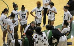 The Lady Saints huddled together and got plans for the next play that they could execute after the timeout had ended. (file photo)