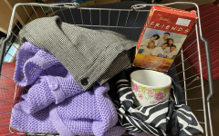 "Raven Staten shows her Saturday thrift finds which include a pair of wool houndstooth pants, a lavender cardigan, a zebra print silk scarf, a floral mug, and volume 3 of ""The best of Friends"". Believe it or not this was all $4.50!"