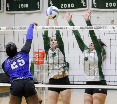 Lady Saints Brooke Katen and Gabriela Badilla block Pratt Community College's Avery Smith at the net. Seward had six blocks on the night in the 3-0 win over the Beavers. SCCC now advances to the se