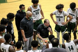 Jason Sautter, head men's basketball coach, draws out a play during a timeout. The coach and entire team was recently suspended for three-games by the college after an altercation against Dodge City Community College's team. They will not play tonight's regularly scheduled game. You may catch them back on the court Wednesday in Garden City.