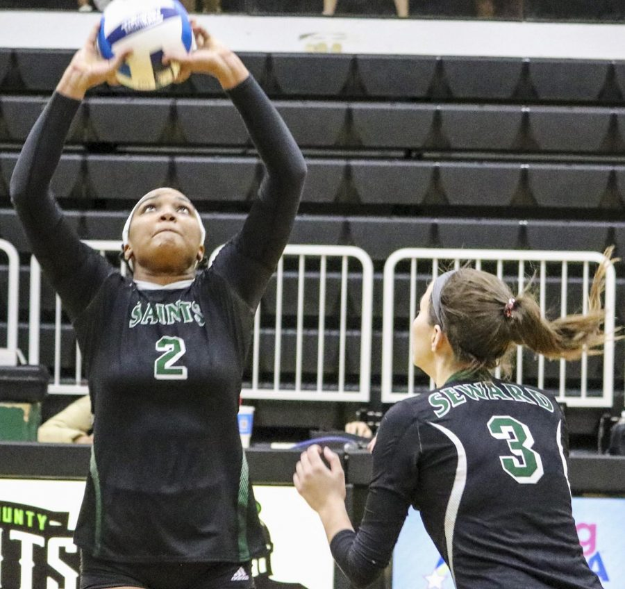 Ileim Terrero, freshman from Santa Domingo, Dominican Republic, calls a play and sets up Brooke Katen. Terrero has had to take on more responsibility on the court with the injury to Yunju Lee.