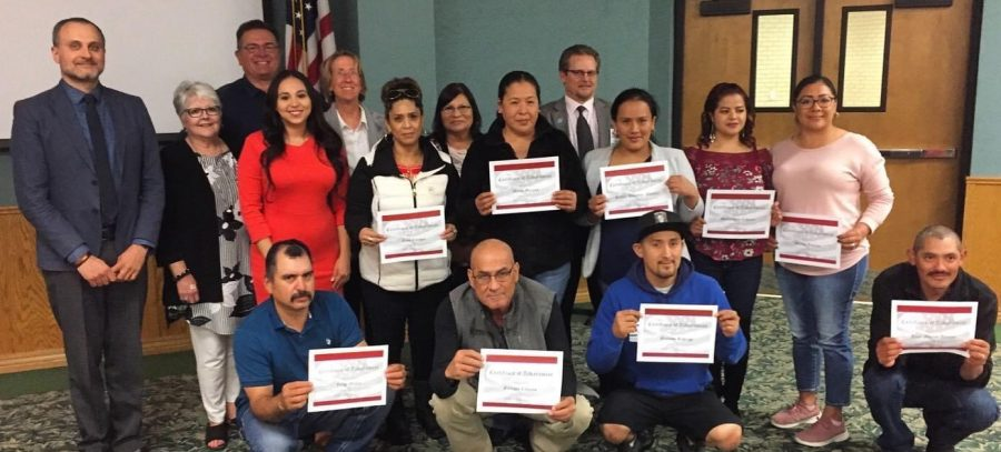 After a lot of studying and hard work, students show off their certificates for earning their citizenship.