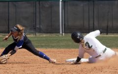 Jaci Oakley slides into second base and is called safe by the umpire. The Lady Saints won both games against Pratt Community College.