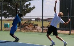 The men's tennis team practices serves. They've had a long break between their last match against Barton Community College on April 17 and heading to nationals this weekend. The monthlong break helped to heal injuries and get fresh legs.