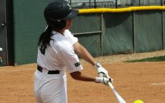 Ashley Low swings big and comes up with a home run against Northwest Kansas Technical College. Low, a center fielder for the Lady Saints is a freshman from Calgary, Canada. The Lady Saints won the first game against NWKTC 18-1 and the second game 9-5.
