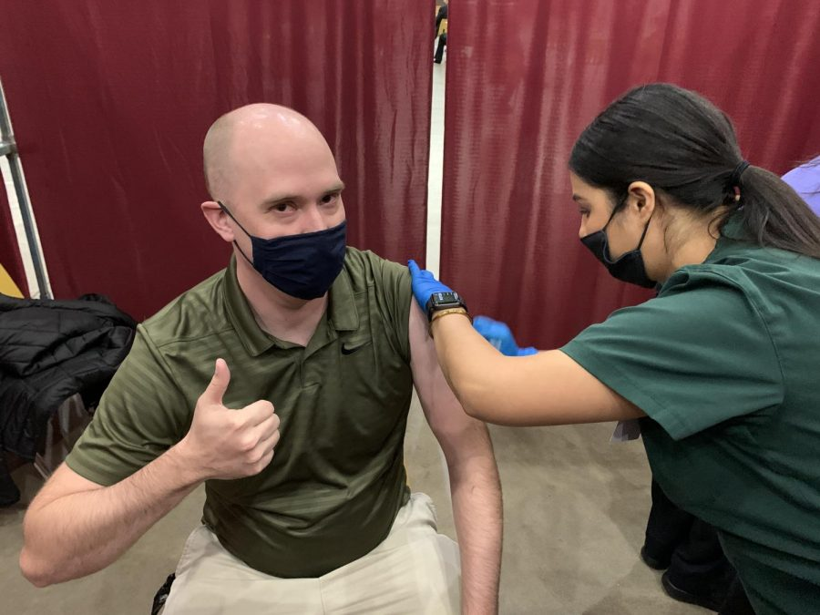Josh Revord, SCCC's website specialist, receives a COVID-19 vaccination from one of the college's nursing students. The students helped out at vaccination clinics throughout the semester as part of their clinicals. The activity not only helped them gain experience but also served the community.