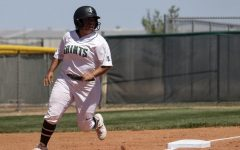 AJ Luna rounds third after Jacie Scott hit a line drive to right field. The Lady Saints scored five runs in the last inning to notch the win.