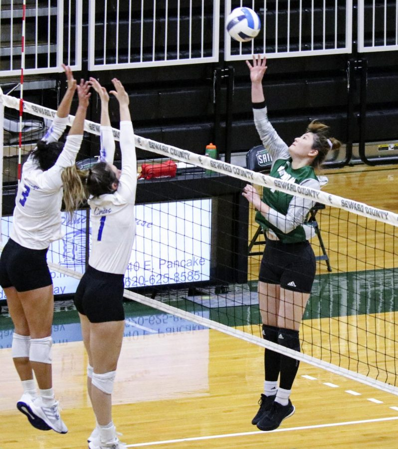Seyun Park goes for one of her trademark kills. Barton Community College's Tasiah Armstrong and Addison Crites try to block the ball. The Lady Saints lost to Barton in the Region VI championship game, dashing hopes of making it to nationals for a third straight year.