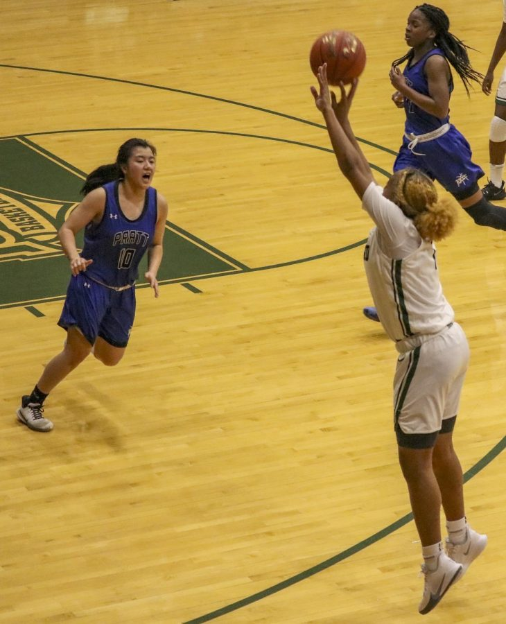 Freshman Zhane Thompson shoots a three pointer and makes it.  Thompson made a total of 18 points throughout the game.