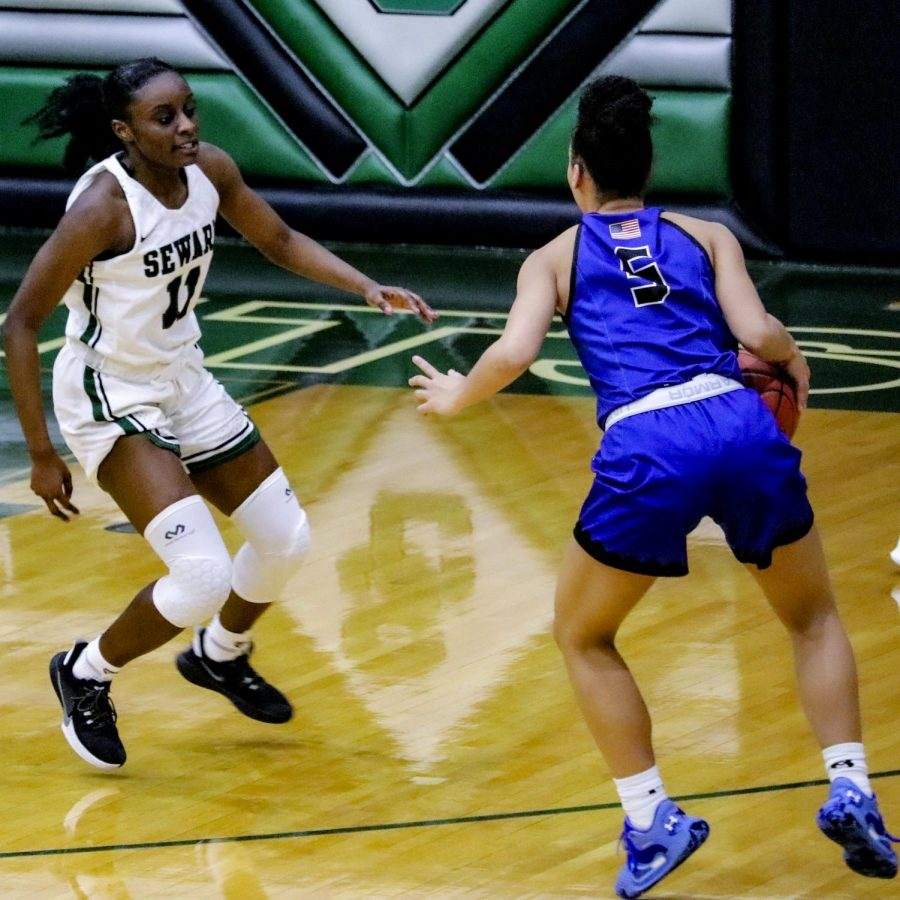 Madina Camara  a freshman from Maputo, Mozambique defends the basket from Pratt. Camara made a total of seven points for the Lady Saints during the game. The Lady Saints will be going to the first round of the playoffs on April 5.