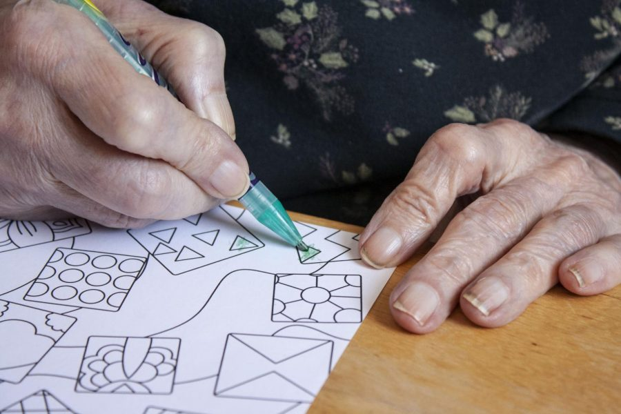 Coloring pictures is a regular pastime for Anne McKeown. Even though McKeown's progressing dementia has lessened her ability to color more intricate pictures, she still seems to enjoy the activity, according to her caregivers.