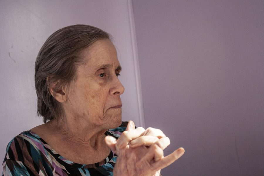 """Anne McKeown sits in her bedroom. """"When she gets that far-off look,"""" says McKeown's daughter Jean Fields, """"you sometimes just have to wonder what's going on in there."""" McKeown's dementia has diminished her ability to communicate. """"Sometimes she can tell us exactly what she's thinking, with or without words, especially if she's mad,"""" Fields adds laughing. """"But it's got to be frustrating for her when the words just can't make their way out."""""""