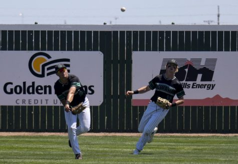 A ball hit to centerfield is gathered by KP Werner and relayed back into the infield. Peter Goldy backs up Werner on the play against Garden City Community College on Thursday. The Saints lost both games 5-8 and 5-17.