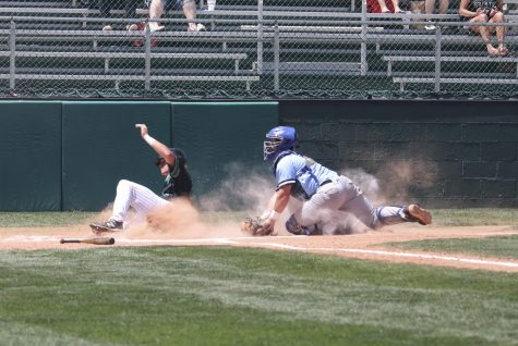 Wyatt Grant slides home on a close call, but is safe. AJ Folds hit the ball that sent Kase Johnson and Grant across the plate.