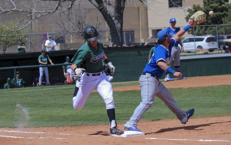 Pushing through, Peter Goldy beats the throw to the first in a game against Butler Community College. Goldy figures out how to get on base for the Saints. His on base percentage is .432 in the last 41 games.