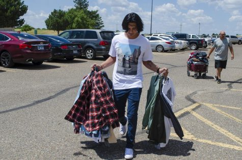 """Javier Victoria, Guymon, Oklahoma, simply grabbed clothes out of his closet at home and transferred them via hangers to his new dorm room at the SLC. This saved time """"unpacking"""" and made for easy storage in his car."""