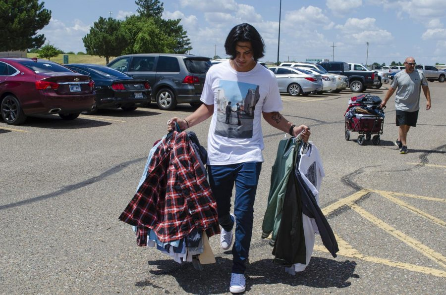 Javier Victoria, Guymon, Oklahoma, simply grabbed clothes out of his closet at home and transferred them via hangers to his new dorm room at the SLC. This saved time unpacking and made for easy storage in his car.
