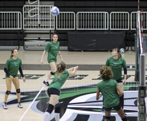 As the team scrimmages against each other, the Lady Saints look up to the air to find the ball. Malena Catala, a freshman from Argentina, gets prepared to hit the ball. The volleyball has their first home match and conference game Wednesday at 6:30 p.m. in the Greenhouse.