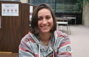 Wiktoria Kazimierowicz takes a break from studying in the library to give an interview.