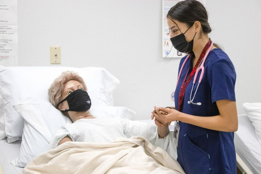 The CNA students have the chance to practice their skills with mannequins. In the picture, high school student Kineshma Camacho practices how to get the patients ready to get up from bed. They try to make the class more fun by naming their mannequins, in the picture we have Mrs. Harriet
