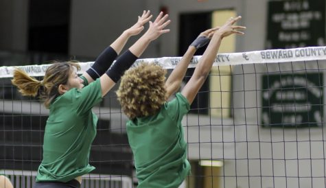 Seyun Park and Sarah Cruz go up for a block during a Lady Saints practice. The team just won four games in Texas over the weekend, bringing their record to 7-2.