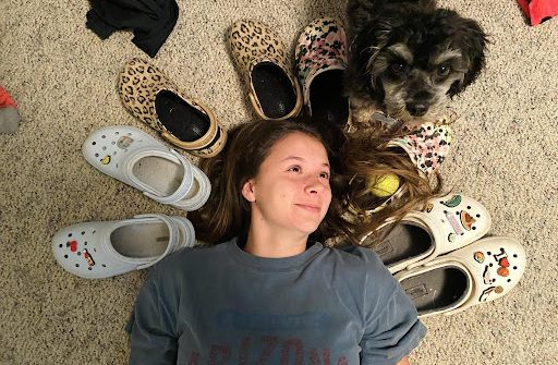 Halle Payton, Liberal freshman, shows off just a few pairs of Crocs that she owns. She claims the shoes are comfortable and fashionable.