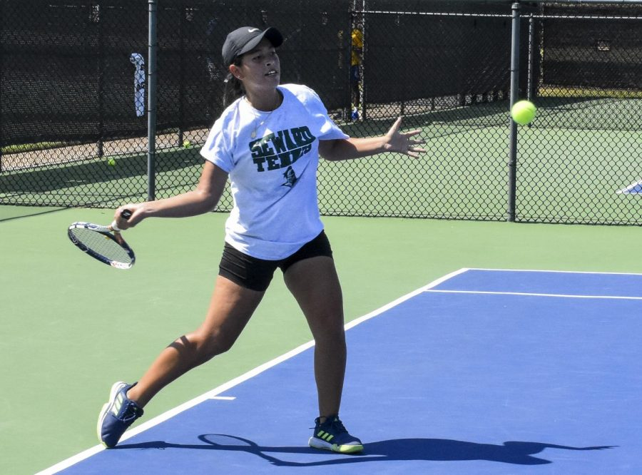 Freshman Alejandra Sandoval hits a forehand in her first match in Oklahoma City during a weekend tournament Sept.17-8.