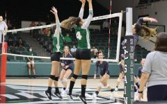 Brooke Haten and Ana Cambraia go up to block a ball from a Lady Rattler. Haten and Cambraia are both middle hitters for the Lady Saints.