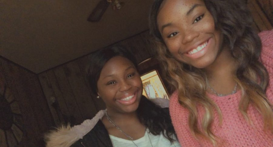 Katie and Shatarrika Ross show their smiles while taking a selfie together at their house. The twins have grown up in Liberal.