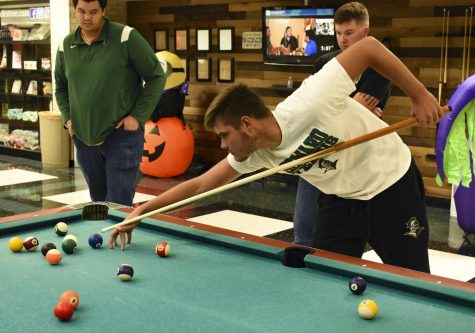 A champion at work, Karlos Krolo, a freshman sports management major, sets up for a  tricky shot. Krolo went on to place first and win the pool tournament hosted by Student Government Association.