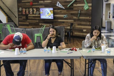 When the competition starts, the room falls silent. Brianna Domingues, Lupita Ugalde and Kris Cruz quickly stuff their mouth with a jalapeno rushing for a chance to win the big prize of $100.