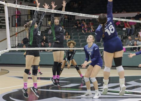 Berfin Mertcan and Seyum Park go up to block the ball coming from the Lady Trojan Savannah Adams. Park is a middle and outside hitter for the Lady Saints and has a block assist overall of 33.